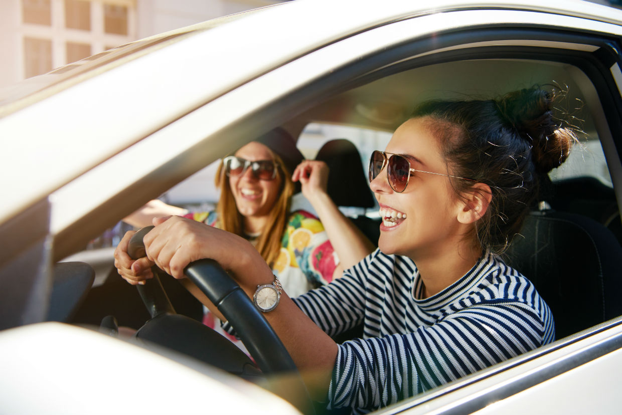 Women listening to music in a car